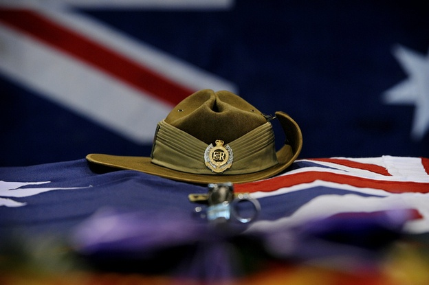 Australian national flag rest upon the casket of Cpl. Richard Atkinson during a memorial service at Multinational Base Tarin Kot on February 5, 2011 in Uruzgan, Afghanistan. Lest we forget.