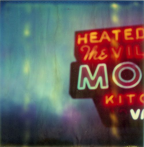 really like this--The vintage Vacancy Motel sign, the fact that the rooms are heated, plus the rain. :)