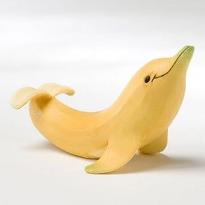 Transform a banana into a dolphin. Awesome beach party decorations! Set one at each plate!