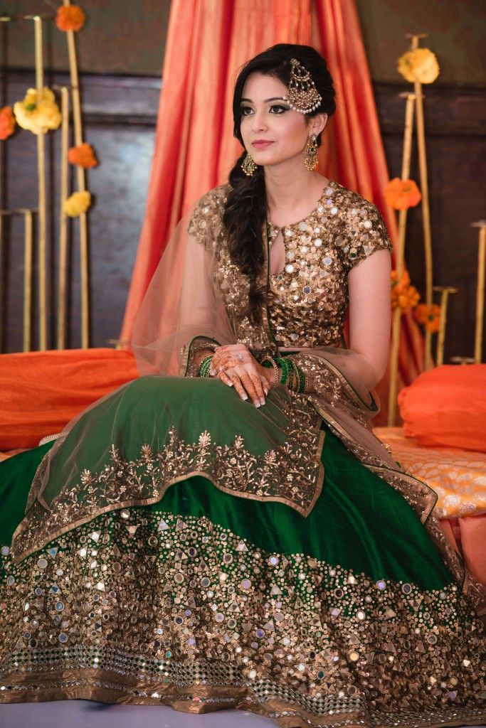 Mehendi Outfits - Green and Gold Lehenga with Beige Net Dupatta | WedMeGood #indianbride #indianwedding #mehendioutfit #green #bottlegreen #sequinned #beige #net #jhoomar
