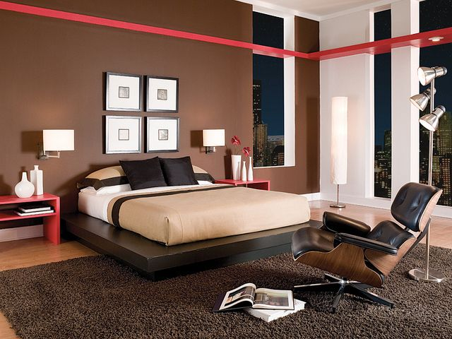Dark brown and bold red accents go well in a masculine bedroom. Modern Bedroom, via Flickr.
