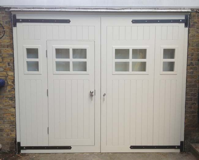 Garage door with entry door via                 http://www.jonathanelwellinteriors.co.uk