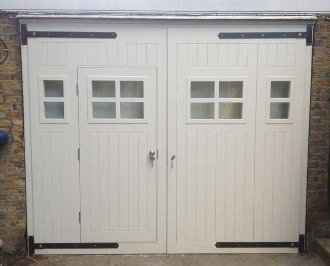 Garage door with entry door via                 http://www.jonathanelwellinteriors.co.uk