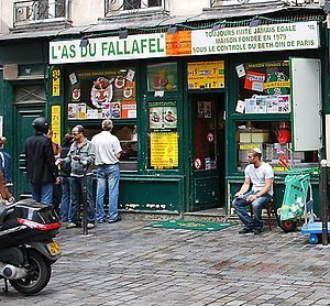 """L'As du Fallafel (English: The Ace of Falafel) is a Kosher Middle Eastern restaurant located at 34, Rue des Rosiers in the """"Pletzl"""" Jewish quarter of the Le Marais neighborhood."""