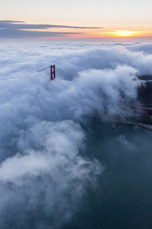Let us bless The imagination of the Earth, That knew early the patience To harness the mind of time, Waited for the seas to warm, Ready to welcome the emergence Of things dreaming of voyaging Among the stillness of land.~John O'Donohue Aerial Golden Gate Bridge Sunset | Toby Harriman