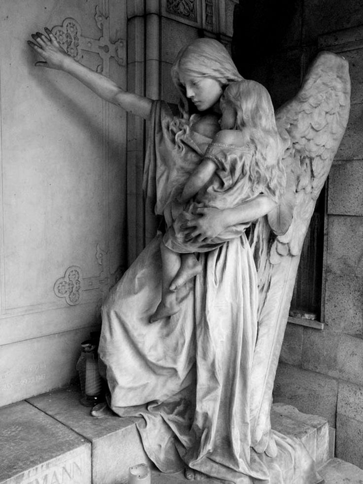 guardian angel ;  Angel statue in the graveyard of Trzic, Slovenia.   (Photo by lordradi)