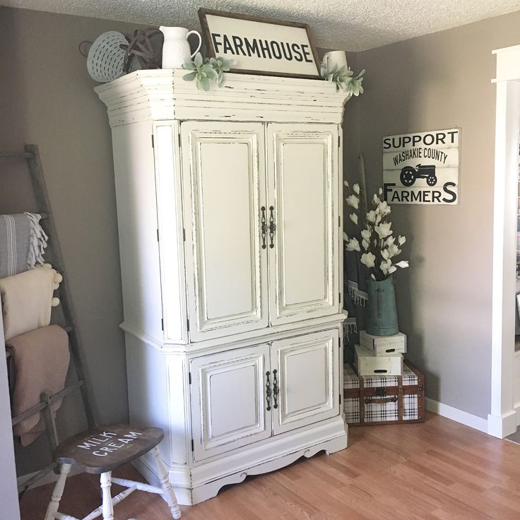 Repurposed tv armoire into a home office.
