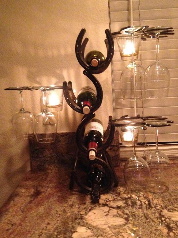 Home made wine rack made with real horseshoes.This rack holds 4 wine bottles, 12 wine glasses and 3 candles. on Etsy, $176.00