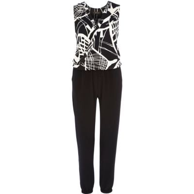 I'm shopping Black abstract print sleeveless jumpsuit in the River Island iPhone app.