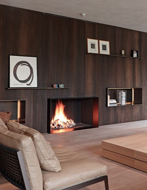 Minimal living room uses wood paneling to add warmth and richness without visual…