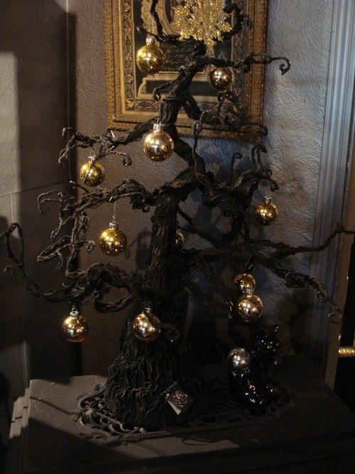Gothic black Christmas tree with gold ornaments for a spooky holiday