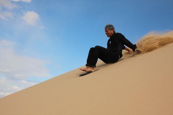 Port Stephens 4WD Tours sandboarding on Sockton Dunes