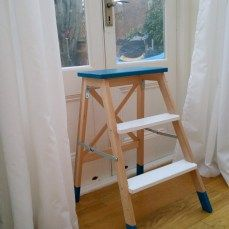 Style your basic Ikea steps in white and teal blue and make it a decoration piece
