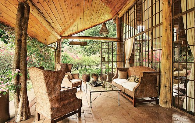 I love this outdoor space and wall of windows