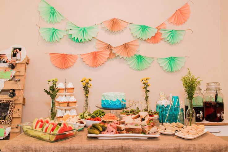 Mint and peach table set up for bridal shower