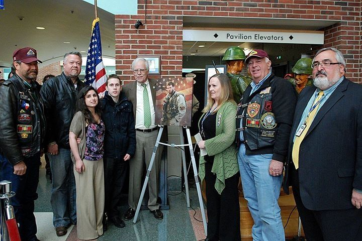 Members of a the Patriot Guard Riders from Texas flew in today to present an amazing painting of Lt. Michael Murphy to his family. Lt. Murphy's mother Maureen cares for veterans as an employee here at Northport VAMC. Check out his medal citation for the Medal of Honor. http://www.cmohs.org/recipient-detail/2199/murphy-michael-p.php