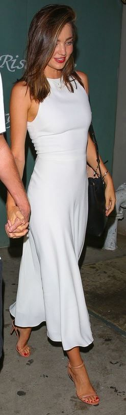 Miranda Kerr: Ring – Swarovski Purse – Mansur Gavriel Bracelet – Mcs Elena Shoes – Alexander Wang Dress – Halston