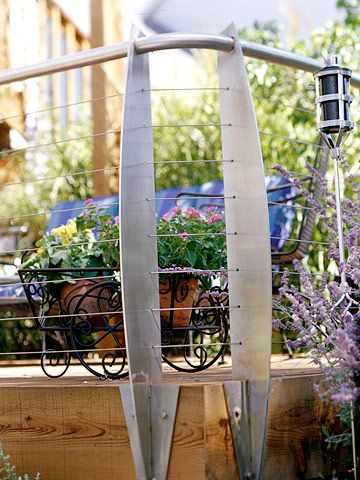 Modern Materials: The top-rail tubing, flat posts, and thin cables offer an unmistakably contemporary look and create little obstruction when it comes to backyard views. The stainless steel is virtually maintenance-free because it won't corrode.