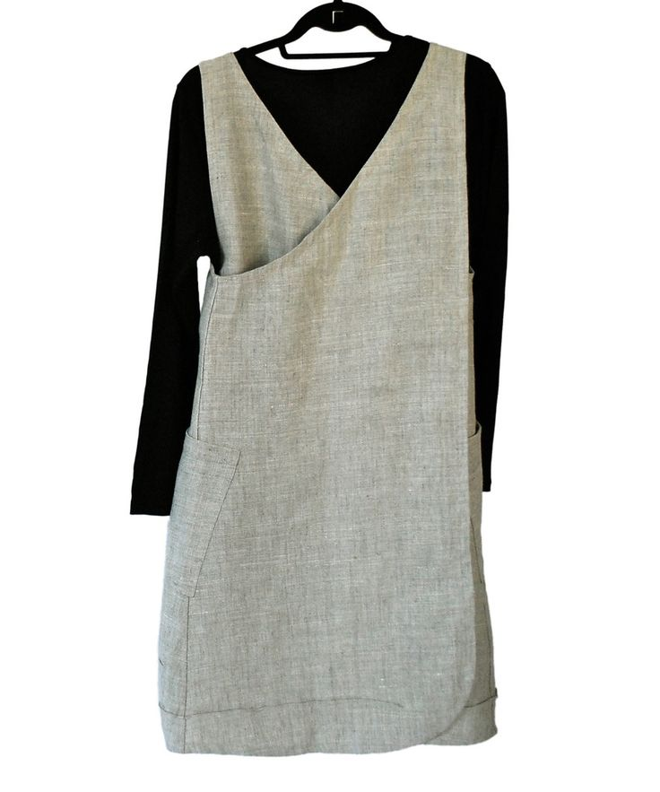 This is the dress you have been waiting for. A crisscross, vee back pinafore with two big pockets and chic pin tucks for a flattering shape. No buttons, no z...