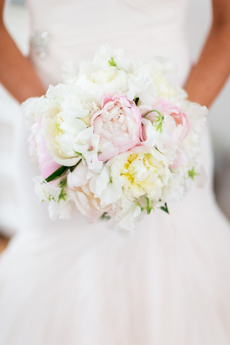 Lush blooms with a hint of pink. Photography: Jonathan Young Weddings - www.jyweddings.com, Floral Design: Karen Lenahan - klenahandesigns.com  Read More: http://www.stylemepretty.com/tri-state-weddings/2014/04/22/glamorous-east-hampton-wedding/