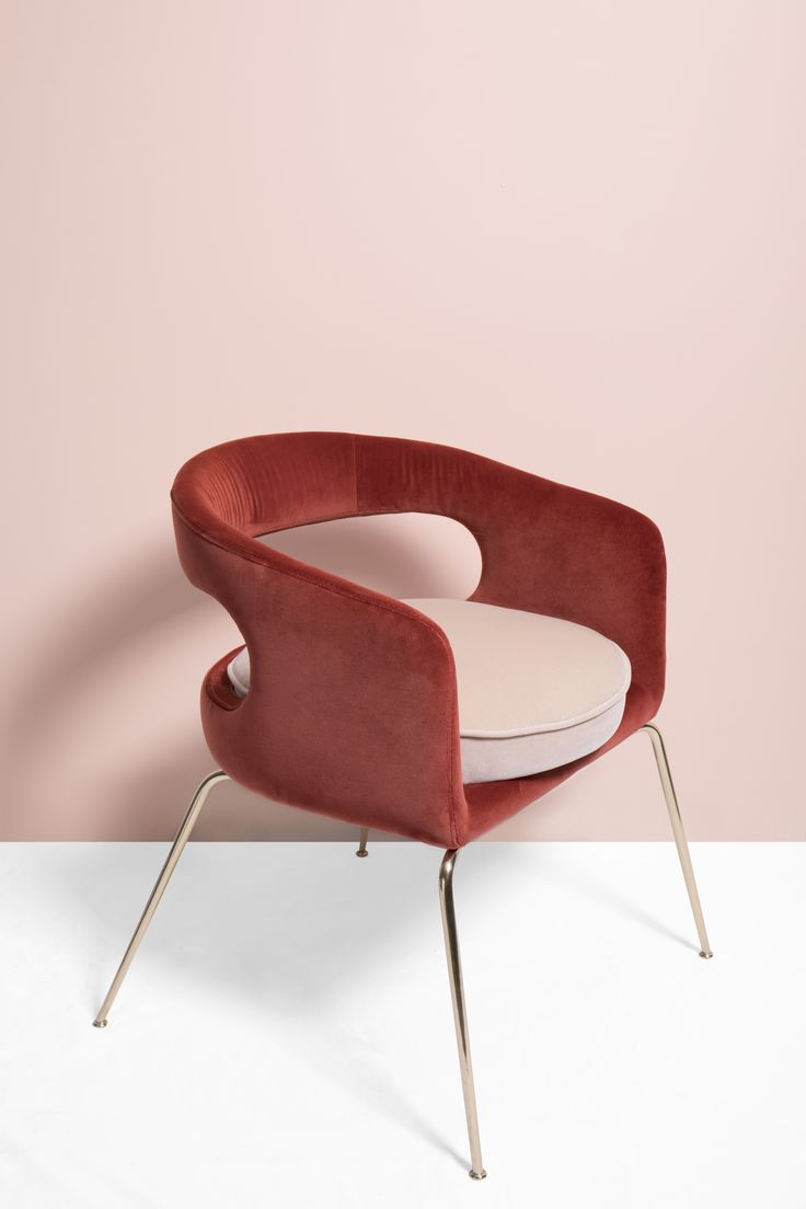 http://inspirationdesignbooks.com/  Ellen is a fanciful dining chair full of luxurious features. Its distinctive open curved back is extremely sculptured and it contrasts with the slim legs made of polished brass.