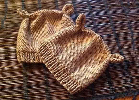 "This adorable newborn baby hat is easy to knit and only takes about 2 hours from start to finish. The hat features ribbing at the brim, reverse stockinette texture, and little chipmunk ears. The pattern pdf includes hyperlinks to Knit Darling video tutorials that explain how to do <a href=""http://www.knitdarling.com/videos/the-mattress-stitch-sewing-for-knitters/"">the mattress stitch</a> and..."
