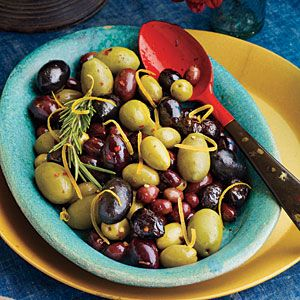 Warm Lemon-Rosemary Olives  3 cu mixed olives, 2 rosemary sprigs, 1 t. dried crushed red pepper, 1 t. lemon zest, 1 t. olive oil.  Place in foil packet, Bake at 400 for 30 mins.
