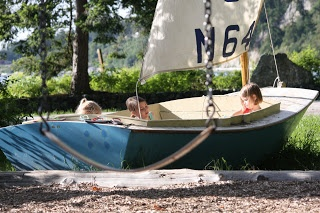 Turn a vintage boat into a sandbox. Can also convert to a flower bed when kids outgrow it.