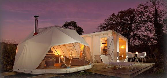 geodesic tents with decking.  how awesome would it be to camp out in these?!  WOW!!