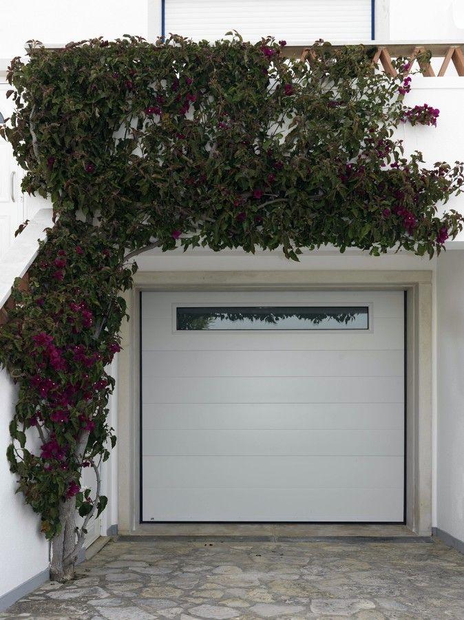 Panel liso y ventana panorámica