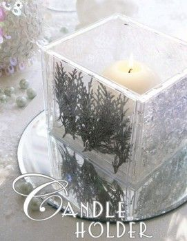 Today, Bird of Bird's Party has shared another great holiday diy project with us. This cd case candle holder is so clever and easy to do. You can create it to suite whatever decor you're working with, and place them as centerpieces or on side tables. It sort of reminds me of a block of ice with a