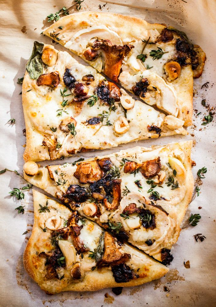 pizza with mushrooms, hazelnuts, cream sauce, two cheeses, thyme + sage