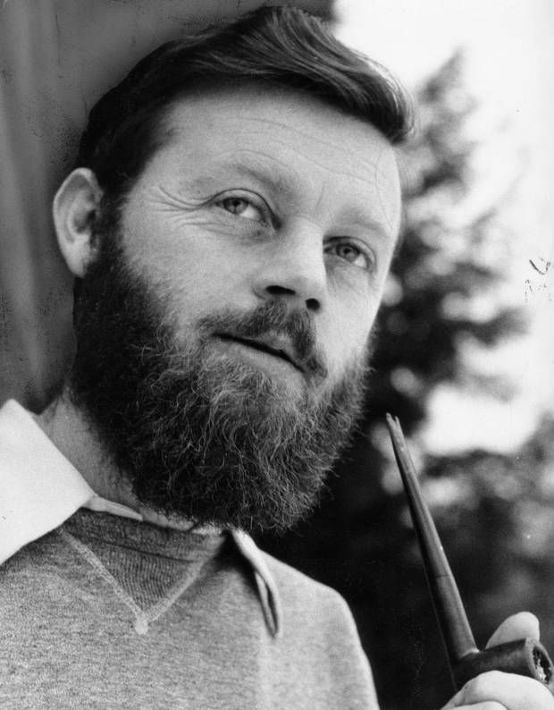 FEBRUARY 6, 1958 -- Author Farley Mowat, pipe in hand, outside his log cabin near Palgrave, Ontario. (Erik Christensen For The Globe and Mai...