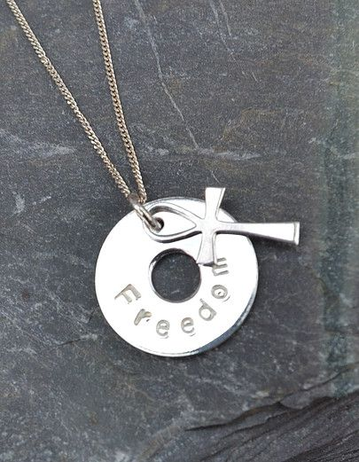 The Embrace range is inspired by Gods embracing love. Silver washer and discs with stamped or engraved words.