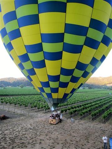 A hot air balloon in a Napa Valley vineyard