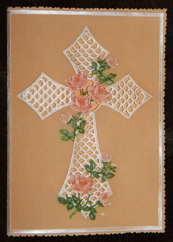 A delicate and pretty sympathy card, an ornate cross decorated with roses.