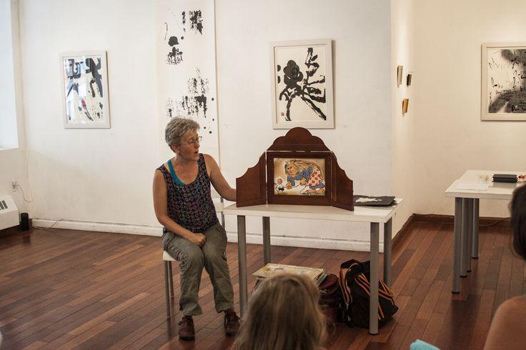 Tara McGowan telling a tale with kamishibai, Japanese paper theater   RESOBOX Gallery