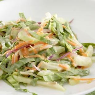 Crunchy Bok Choy Slaw Recipe - 1/4 cup rice vinegar  1 tablespoon toasted sesame oil  2 teaspoons sugar  2 teaspoons Dijon mustard  1/4 teaspoon salt  6 cups very thinly sliced bok choy, (about a 1-pound head, trimmed)  2 medium carrots, shredded  2 scallions, thinly sliced