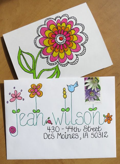 Great lettering on the front. Simple plain large detailed flower on the back of this great envelope.