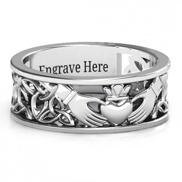#Sterling #Silver #Men's #Celtic #Claddagh #Band #Ring  Centreed with a traditional Claddagh motif and embellished with an open Celtic patterned band, this ring will be custom made with your choice of metal and engraving.
