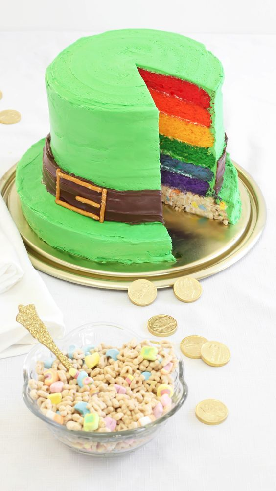 Lucky Charms® Leprechaun Top Hat Rainbow Cake ~ layer cake stack (box yellow cake mix tinted different colors) sitting atop a marshmallow cereal treat base | by Heather Baird via Betty Crocker