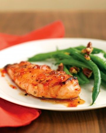 Even with just two ingredients, this easy red-pepper and apricot glaze adds fiery sweetness to skinless, boneless chicken-breast halves. The sugars in the glaze bring out the best in flame broiling.