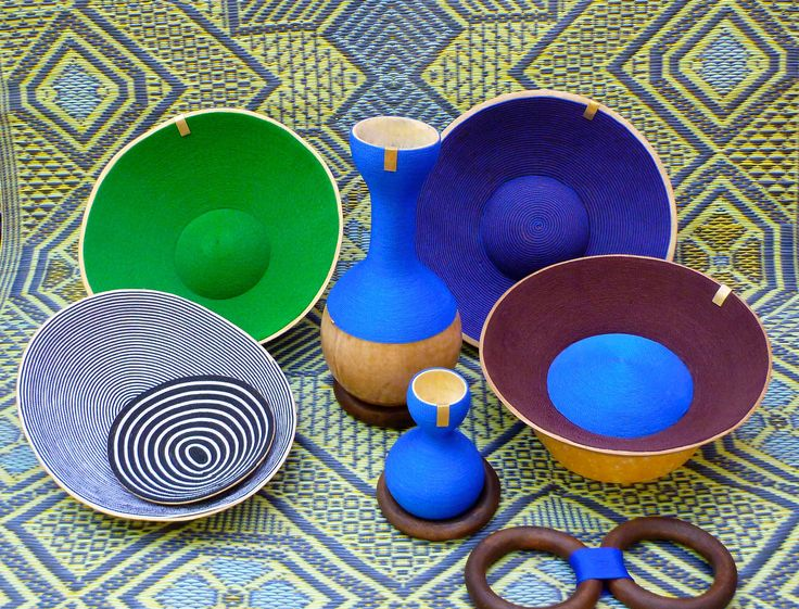 'Agasho', collection of handmade everyday life objects, co-created in Ouagadougou with Tuareg craftsmen & women, refugees from Mali  Materials: Calabash/ Goat leather/ Nylon threads/ Palissandre/ Bronze more here: https://www.facebook.com/designforpeaceproject/?fref=ts