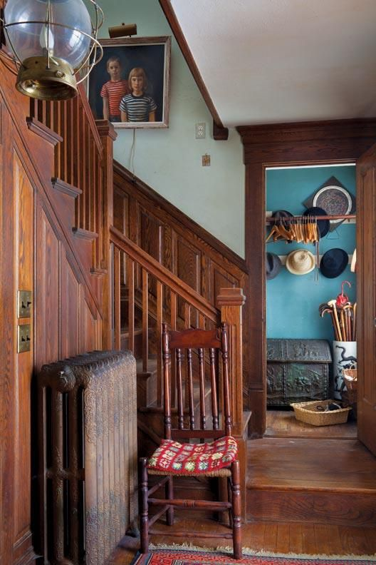 The dog-leg staircase in the entry hall is in the original part of the Cape Cod house. - A Vermont Farmhouse Evolves Over Time - Old House Restoration, Products & Decorating