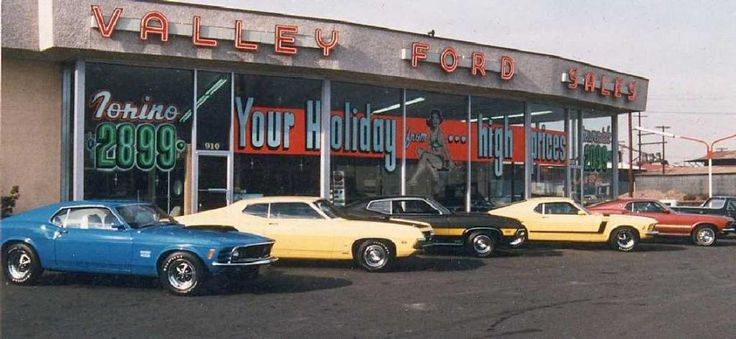 Ford Dealership. Note the price in the window for a new Ford Torino. Torinos were produced between 1968 and 1976.