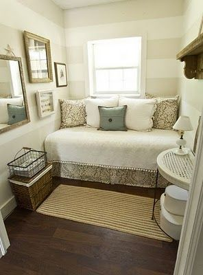 spare room idea..never thought of putting the bed and pillows like that where its like a daybed...hmm i kinda like! would open the room up so much!