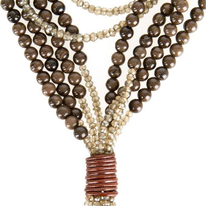 BRUNELLO CUCINELLI - BROWN AGATE AND QUARTZ MULTI-STRAND NECKLACE Long brown agate and brown quartz beaded multi-strand necklace with toggle closure. Made in Italy.