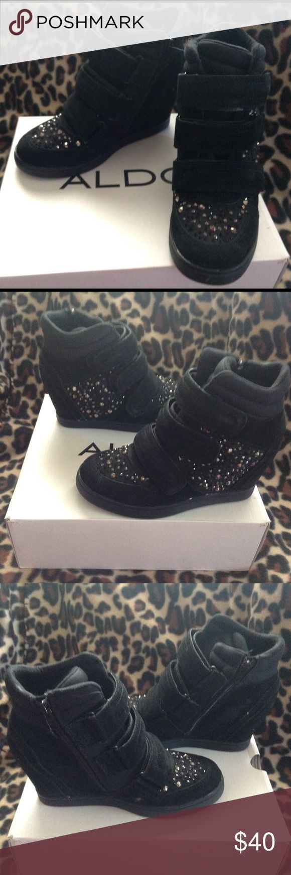 NIB Aldo High Wedge 👟 Sneakers! Brand-new in box ALDO Black wedge sneakers with rhinestones.  Brand-new never worn. Comes with Velcro straps and zipper for easy on and off.  Wedge approximately 4 inches high.  Ultra cute. No stones missing. Size 8. Great deal retail $110. Aldo Shoes Sneakers