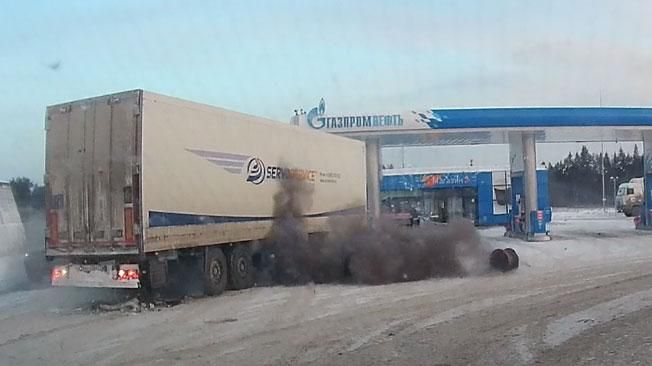 A tire exploded at a gas station in Russia causing snow to fly off of nearby rooftops.