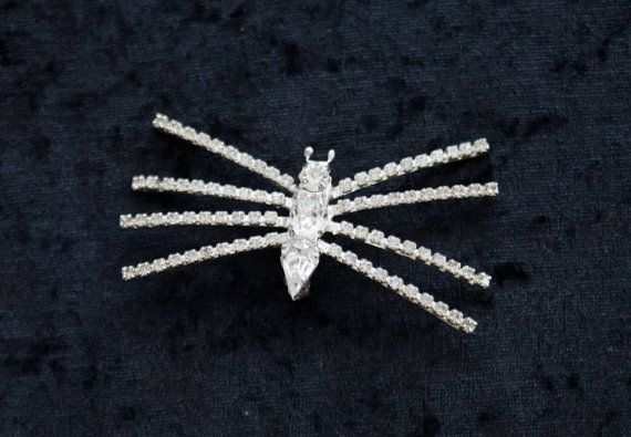 Check out this item in my Etsy shop https://www.etsy.com/ie/listing/252236130/vintage-1950s-rhinestone-spider-brooch